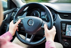 Man presses the buttons on the multifunction steering wheel