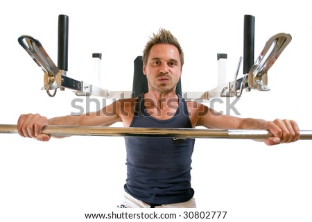 Man pressing barbell on bench - stock photo