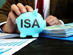 Man proposes piggy bank with word ISA individual savings account.