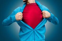 man pulling open shirt showing red t shirt