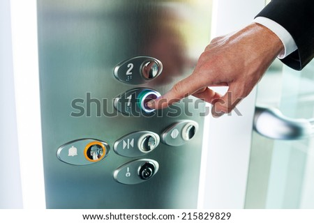 Man pushing button. Close-up of male hand pushing button of elevator