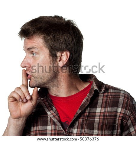 Man puts fingers on lips, telling people to be silent