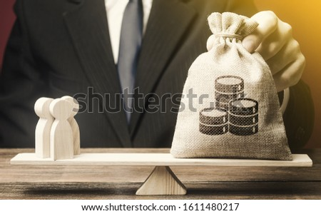 Man puts money bag and people on scales. Taxpayers concept. Decent salary pay for staff specialists. Business, crowdfunding startup. Investments in deposits. Social project financing. Labor migrants. Stock photo ©