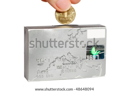 Man putting a coin into a credit card. Conceptual. Savings.