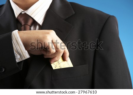 man putting credit card to the pocket