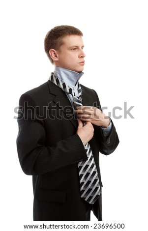 Man putting on necktie, isolated