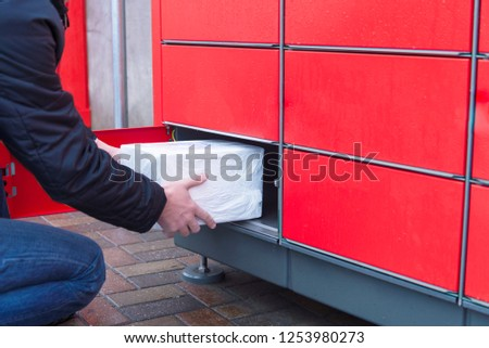 Man putting parcels to pack machine