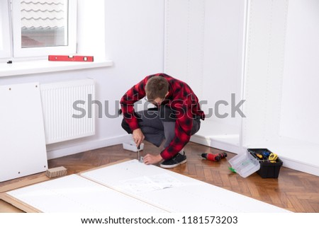 Man putting together  furniture #1181573203