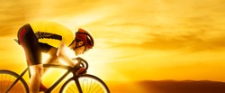 Man racing cyclist in motion on sunset background. Man in yellow cycling jersey.  Sports banner. Horizontal copy space background