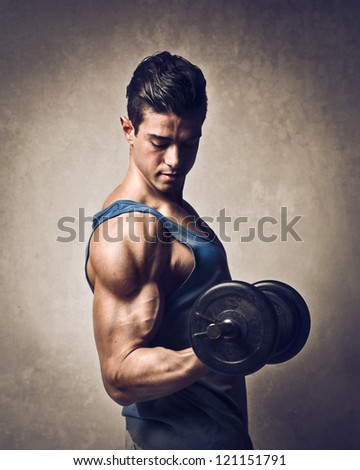 Man raising a dumbbell