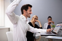 Man Raising Arm With Sweaty Armpit At Office Meeting