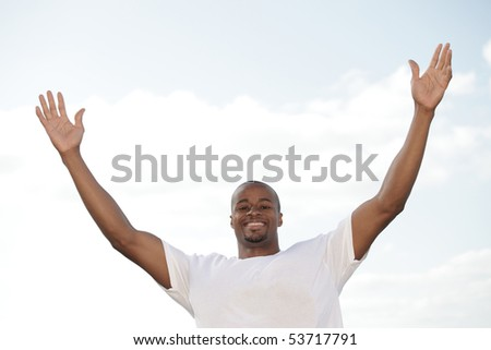 Man raising his arms - stock photo