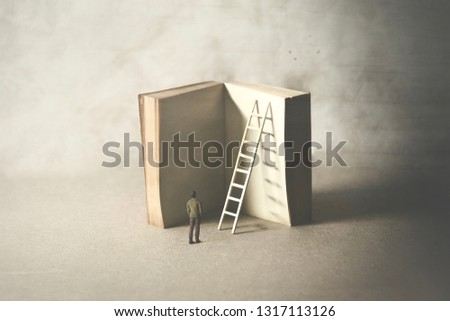 man reaching higher knowledge level, climbing a book, surreal concept #1317113126