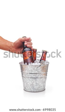 Man Reaching into bucket of beer and removing a bottle, isolated over white