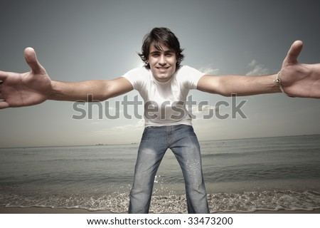 Man reaching out for the camera - stock photo