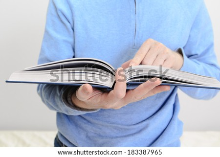 man reading a book