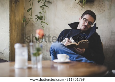 Man reading a book during coffee break