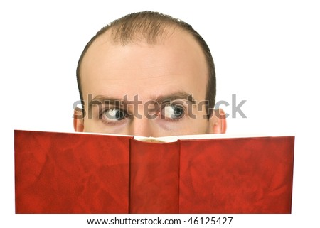 Man reading a thick book