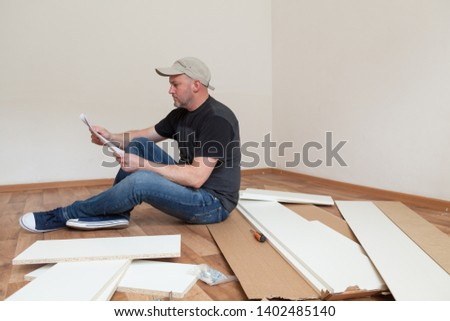 Young man assembling furniture Images and Stock Photos - Page: 4
