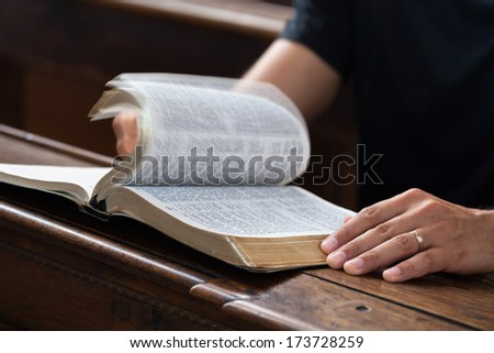 Man reading Bible in the church.