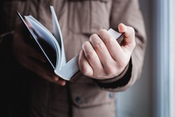 Man reading. Book in his hands.