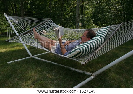 man reading in hammock