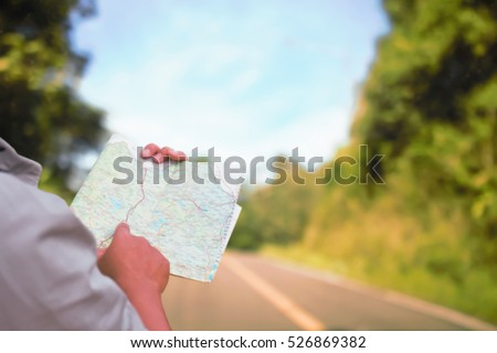 Man reading map soft blur for travel. #526869382