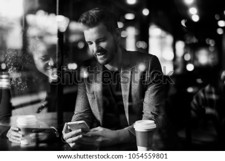 Man reading messages on his phone #1054559801