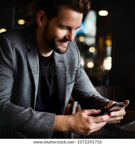 Man reading messages on his phone #1072241756