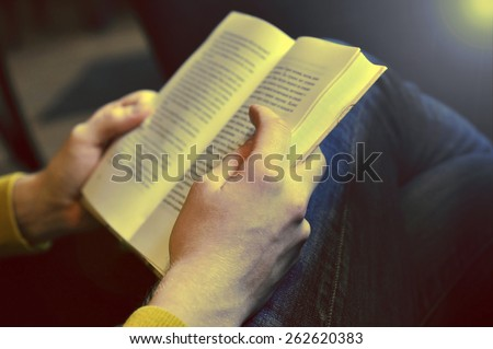 Man reading the book - sepia effect
