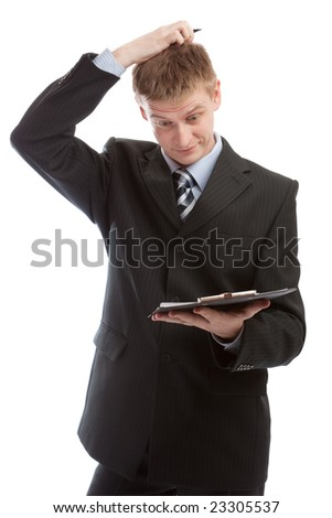 Man reading the document and scratching his head