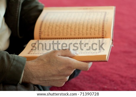Man reading the holy quran - stock photo