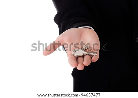 Man real estate agent offering keys studio isolated on white background