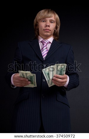 Man recounts money. On black background.