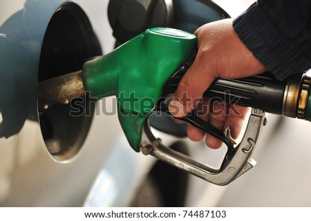Man refilling the car with fuel on a filling station