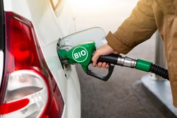 Man refueling the car with biofuel