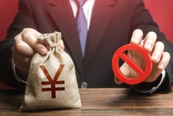 Man refuses to give out chinese yuan or japanese yen money bag. Refusal to provide a loan, bad credit history. Financial difficulties. Asset freeze seizure. Economic sanctions, confiscation of funds.