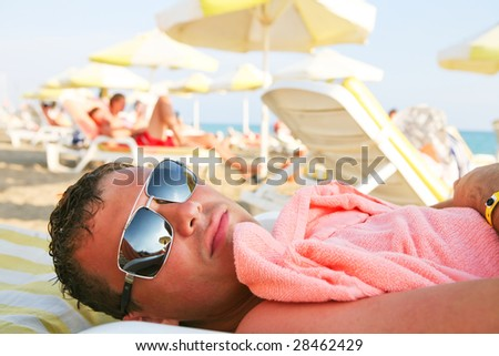 man relax on the beach