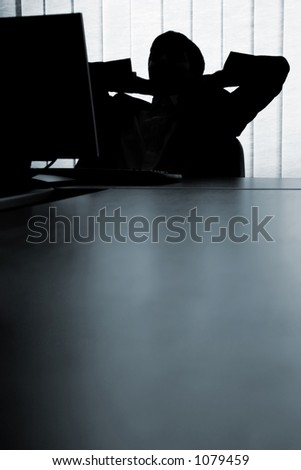 Man relaxing in front of the computer