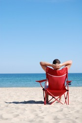 Man relaxing on deckchair