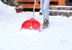 Man removing snow with shovel on winter day, closeup