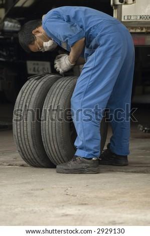 Man repairing a flat tire
