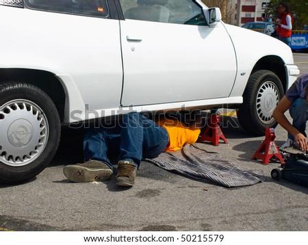man repairing by himself his car
