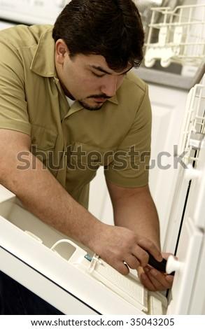 Man repairing dishwasher