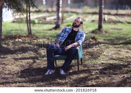 man resting in the village - stock photo
