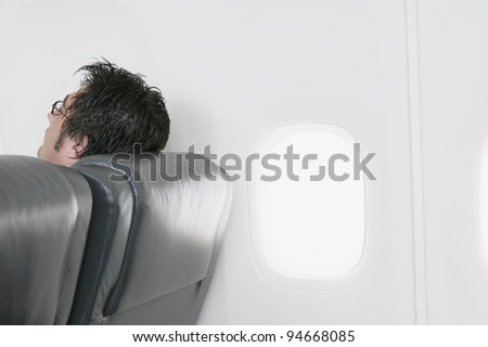Man resting on airplane