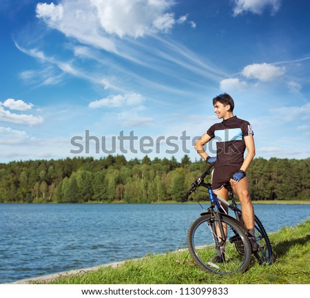 Man Riding a Bike on Beautiful Nature Background