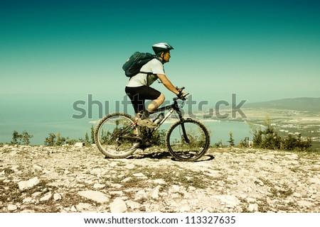 Man riding a bike on the mountain