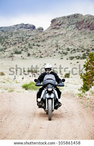 Man riding a Bike through the mountains of Colorado