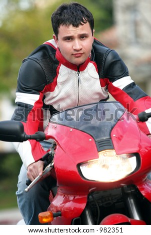 Man riding a red bike - stock photo